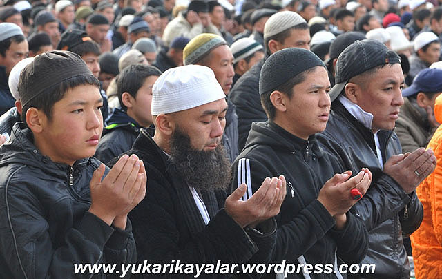 Kyrgyz Muslims take part in their traditional open space prayer at one of the central squares in the Kyrgyzstan's capital Bishkek on October 26, 2012, during the celebrations of Eid al-Adha (Kurban Bairam). AFP PHOTO / VYACHESLAV OSELEDKO (Photo credit should read VYACHESLAV OSELEDKO/AFP/Getty Images)